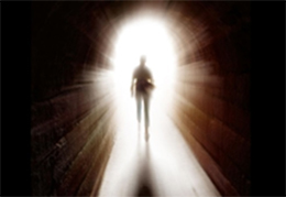 Image of a person walking through the light