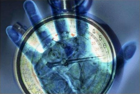 Graphic image of a clock with a hand holding it
